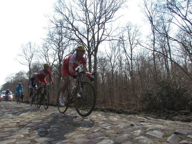Riding the cobbles through the Forest of Arenburg